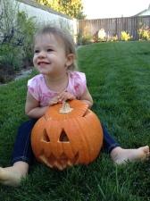 Karen is showing off 'her' pumpkin.